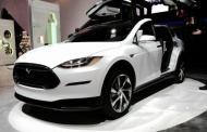 Tesla debuts super fast $130,000 gullwing SUV