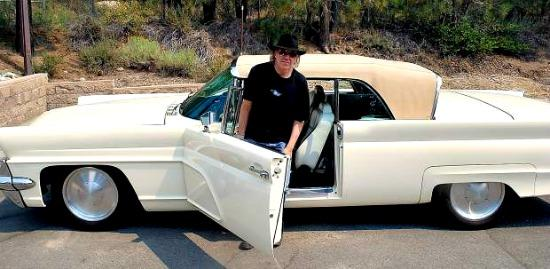 Neil Young and his 1959 hybrid/electric Lincoln.