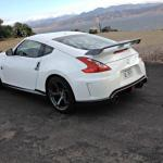 The 2014 Nissan 370Z has a long hatchback window and short roof line.