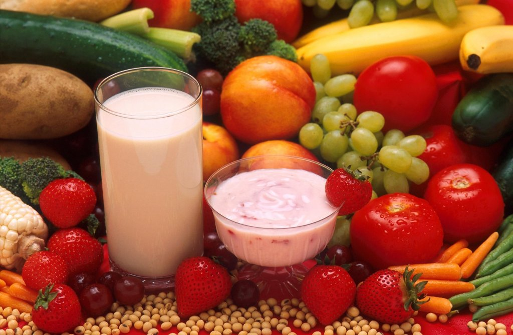 picture of fruit, veggies, yogurt and beans good for digestion and feeding the gut bugs