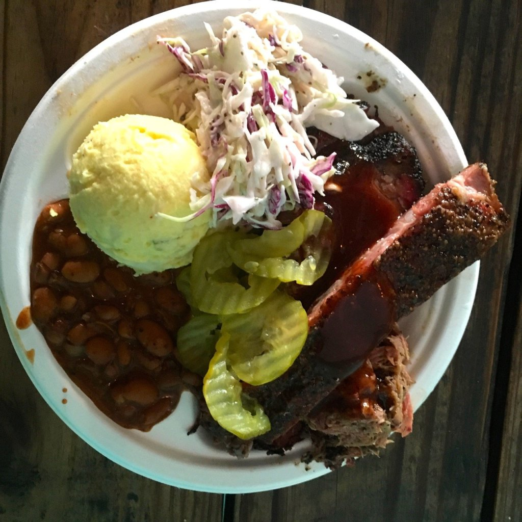 brisket, ribs, pickles, beans, potato salad and slaw from Franklin's BBQ