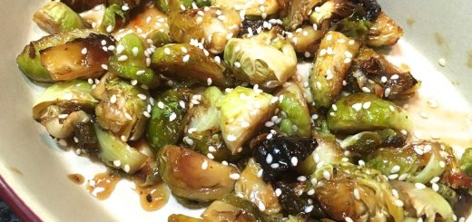 roasted brussels sprouts tossed in garlic coconut aminos and sweet chili sauce with sesame seeds