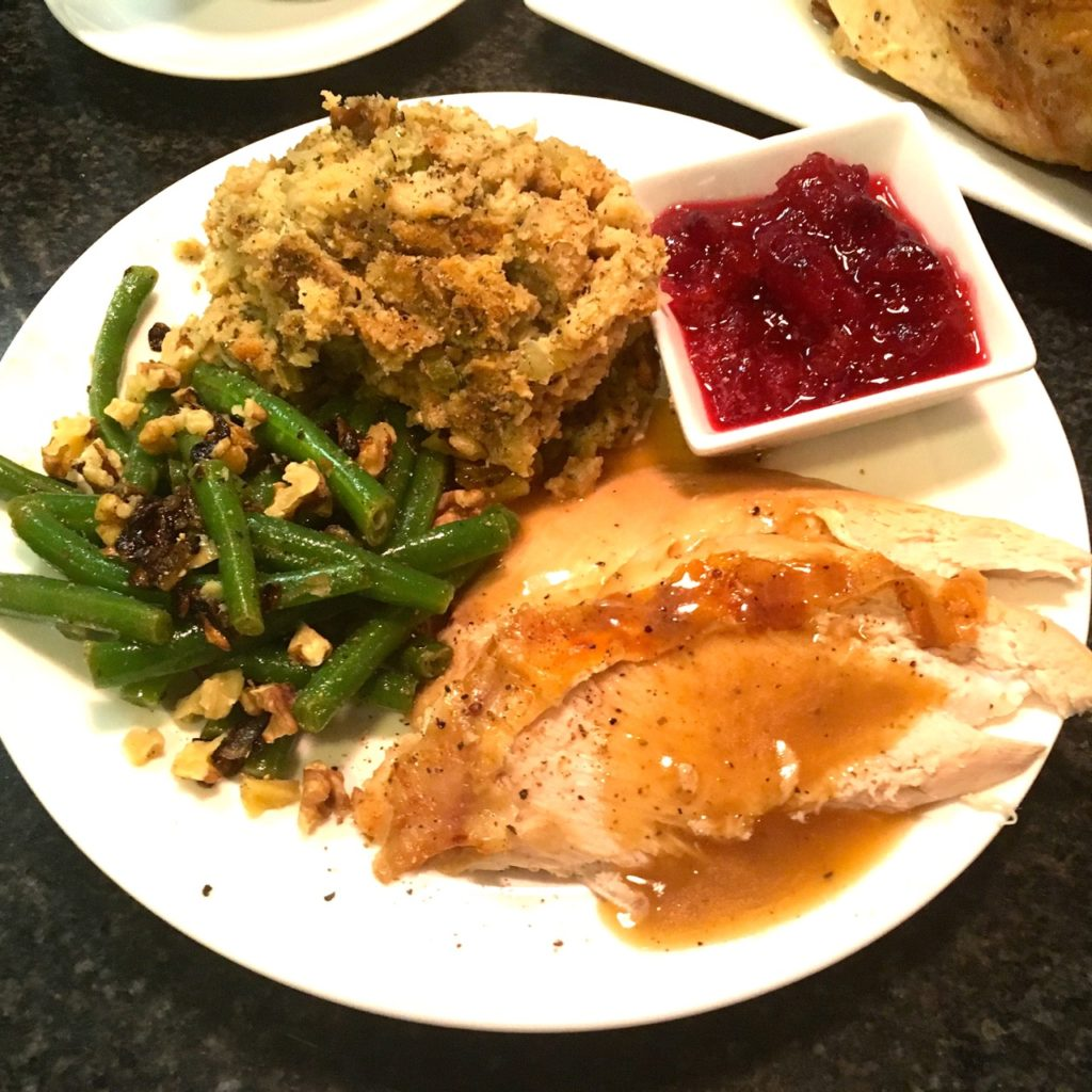 Thanksgiving dinner with fancy green beans, good gluten free stuffing and turkey.