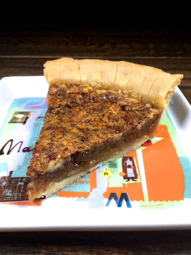 Slice of Gluten-Free Pecan Pie made with Wholly Wholesome pie shell and dark agave instead of corn syrup