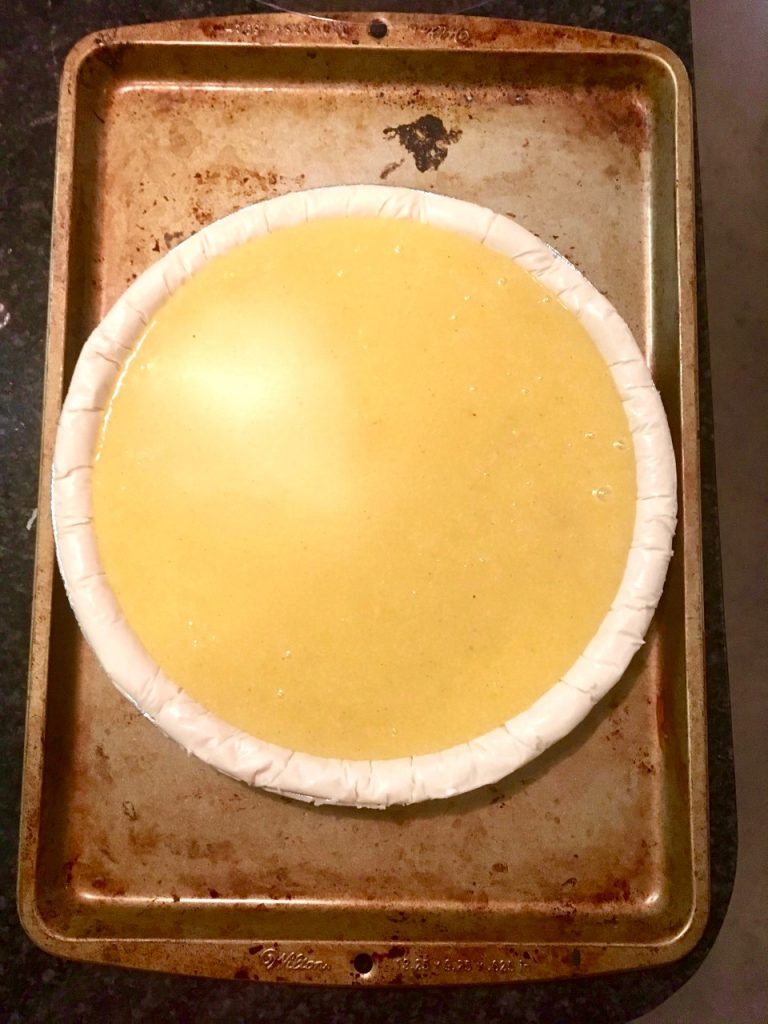 Pour the pie filling into a pre-made gluten-free pie crust on a small baking sheet