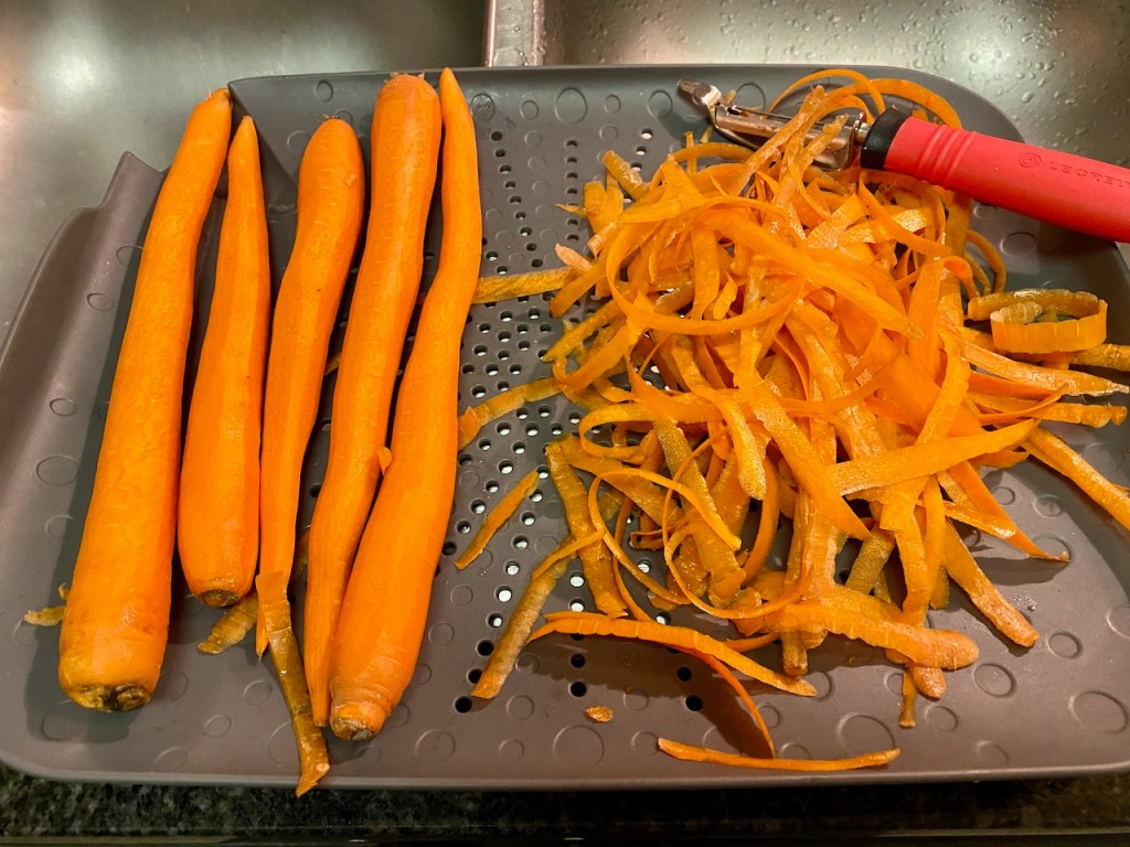 Peeling carrots with our Sinkstation food preparation colander