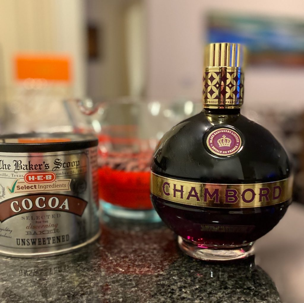 Ingredients for making dark chocolate truffles with Chambord raspberry liqueur