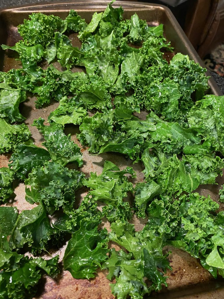 Preparing kale for the homemade kale chips.