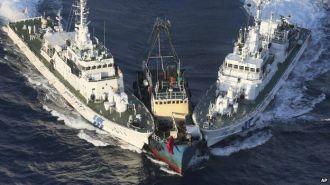 Japanese Coast Guard vessels intercept a Chinese fishing boat near the disputed Senkaku Islands.