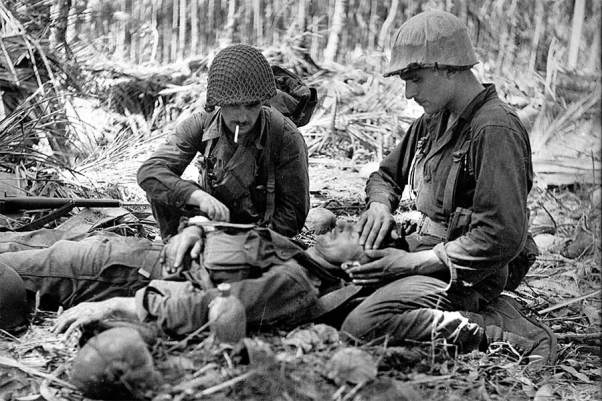 U.S. soldiers tend to the wounds of an Australian serviceman in the Battle of New Guinea in WWII.