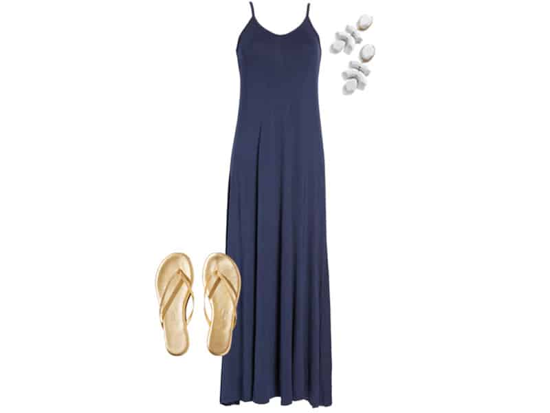 navy maxi dress, gold flip flops, and white earrings