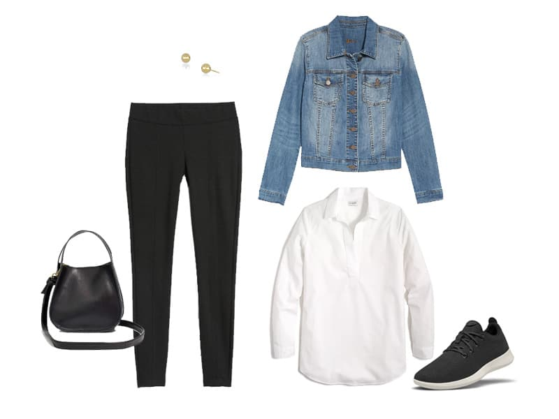 Black leggings with a white popover top, denim jacket, black sneakers, gold studs, and a black crossbody bag.
