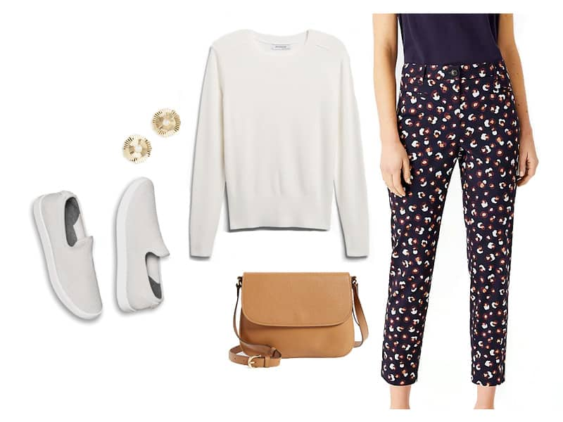 outfit with printed pants, a white sweater, and white sneakers