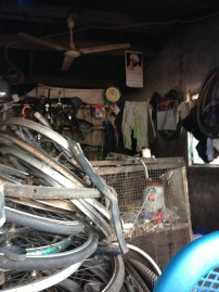 This is Simon's shop. He and his wife and 5 children all live in the back and fix bikes all day long at the front. Like most Ghanaian mechanics, they're constantly short of tools.