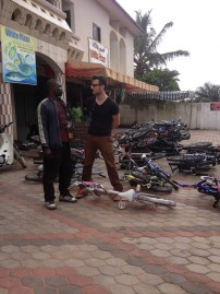 Abotchi and Boss discuss bicycle imports at a container unloading.