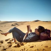 Finishing the Hobbit on a dune.