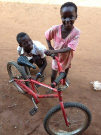 Kwame and Gladys get ready to ride