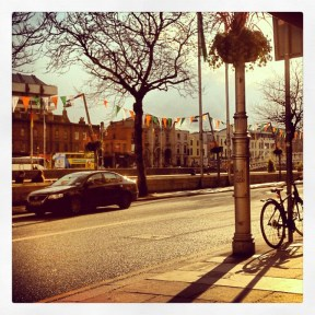 In a cafe outside by the Liffey River
