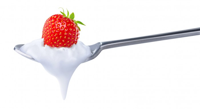 Spoon of strawberry yoghurt