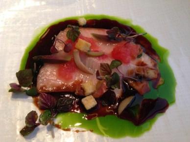 Hamachi crudo, black garlic soy, crushed tomato, basil, olives, shiso (Mendin)