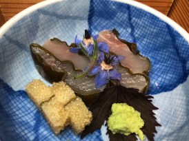 Local SWORDFISH konbujime with komochi knob on shiso with blue borage flowers, hibiscus leaf, and fresh grated wasabi