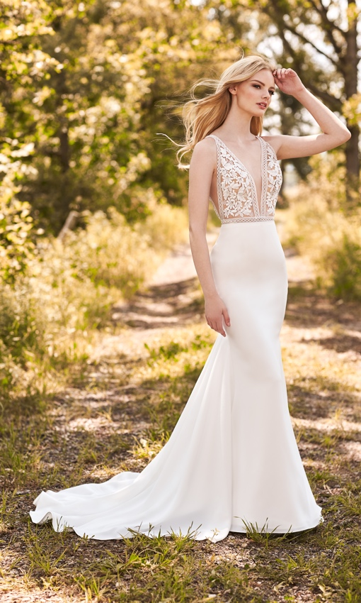 crepe and lace fit and flare wedding gown
