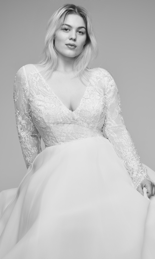 Plus size model in long sleeve v-neckline wedding gown