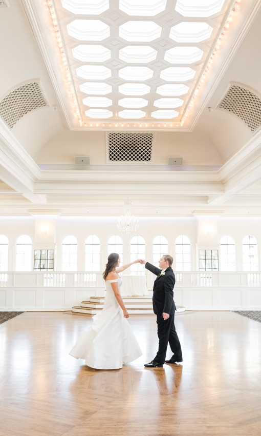 bride and groom dancing in ballroom of the floretine