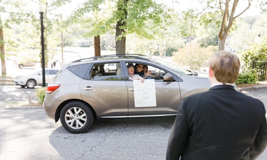 guest driving by to wish happy couple congrats