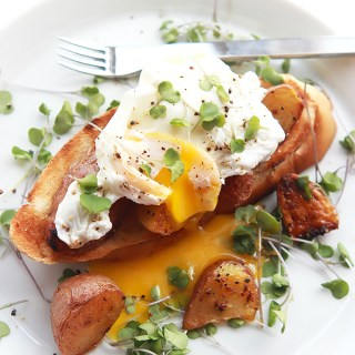 Poached Eggs Over Crispy Potatoes and Toast