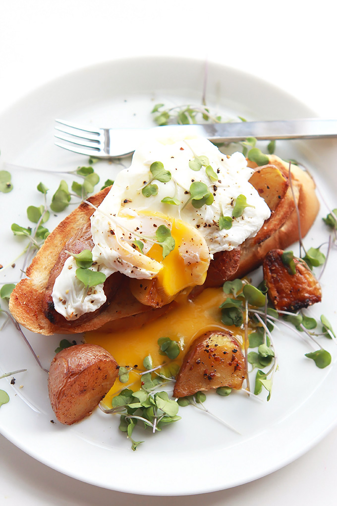 Simple poached eggs over crispy roasted gold and red tiny potatoes and toast. Perfect for a lazy Saturday or Sunday morning breakfast or brunch.