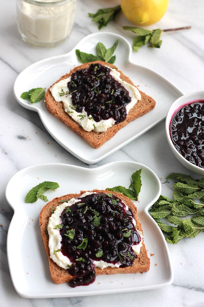 Lemon Ricotta Toast with Wild Blueberry Sauce-Lightly sweetened creamy lemon ricotta on toast topped with sweet juicy wild blueberry sauce, sprinkled with mint. Sumptuosity on a plate.