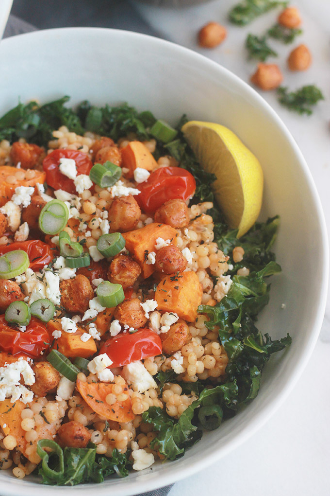 Ready for a supercharged, healthy, hearty salad?  You're going to love this Israeli Couscous Kale Salad with Feta it's made with tender Israeli Couscous, roasted tomatoes, sweet potatoes and chickpeas tossed with seasoned fresh