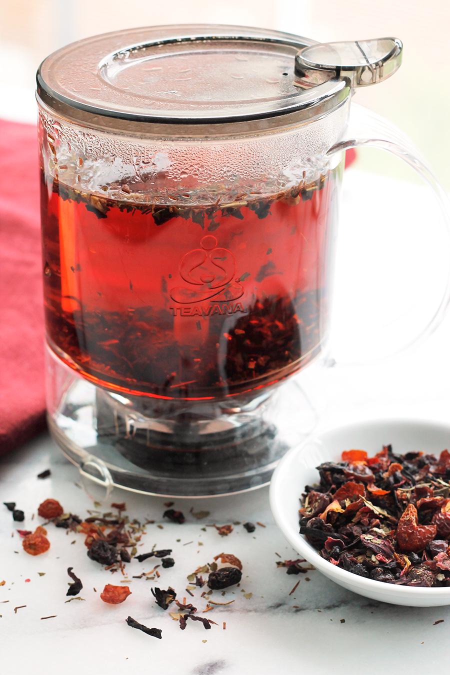 Shot of hibiscus tea in tea maker infuser.