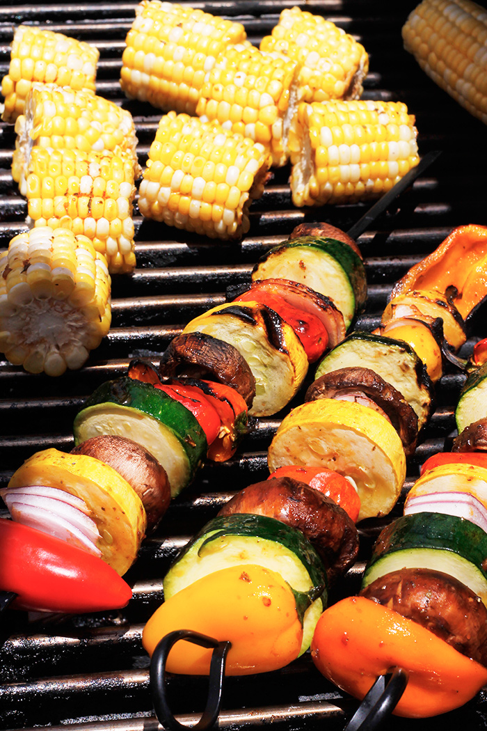 Veggie kabobs and corn on the grill.