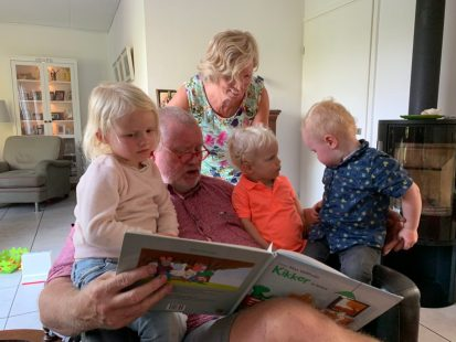 Reading books with granddad