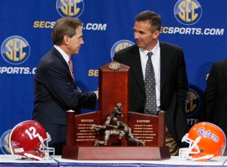 nick-saban-and-urban-meyer-shake-hands-college-football-rivalry