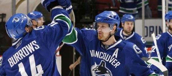 henrik-sedin-celebrates-with-vancouver-teammates