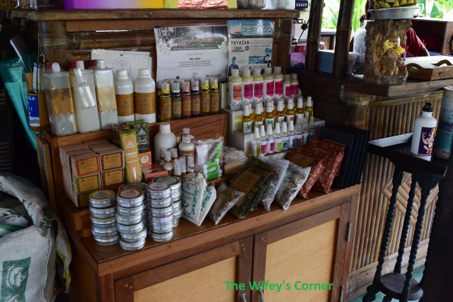 Various organic supplies for sale, such as coconut oil, soaps, incense, etc.