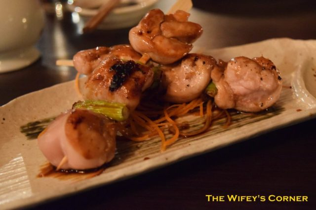 Yakitori - robata-grilled skewers of marinated chicken with baby leeks and teriyaki sauce