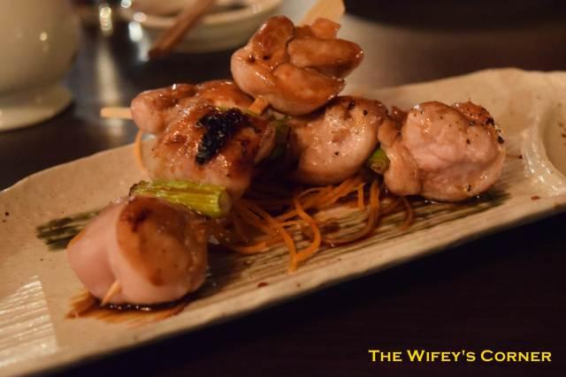 Yakitori - robata-grilled skewers of marinated chicken with baby leeks and teriyaki sauce