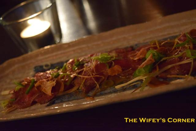 Wagyu Tataki - seared, chilled and topped with bush herbs and soy onion dressing