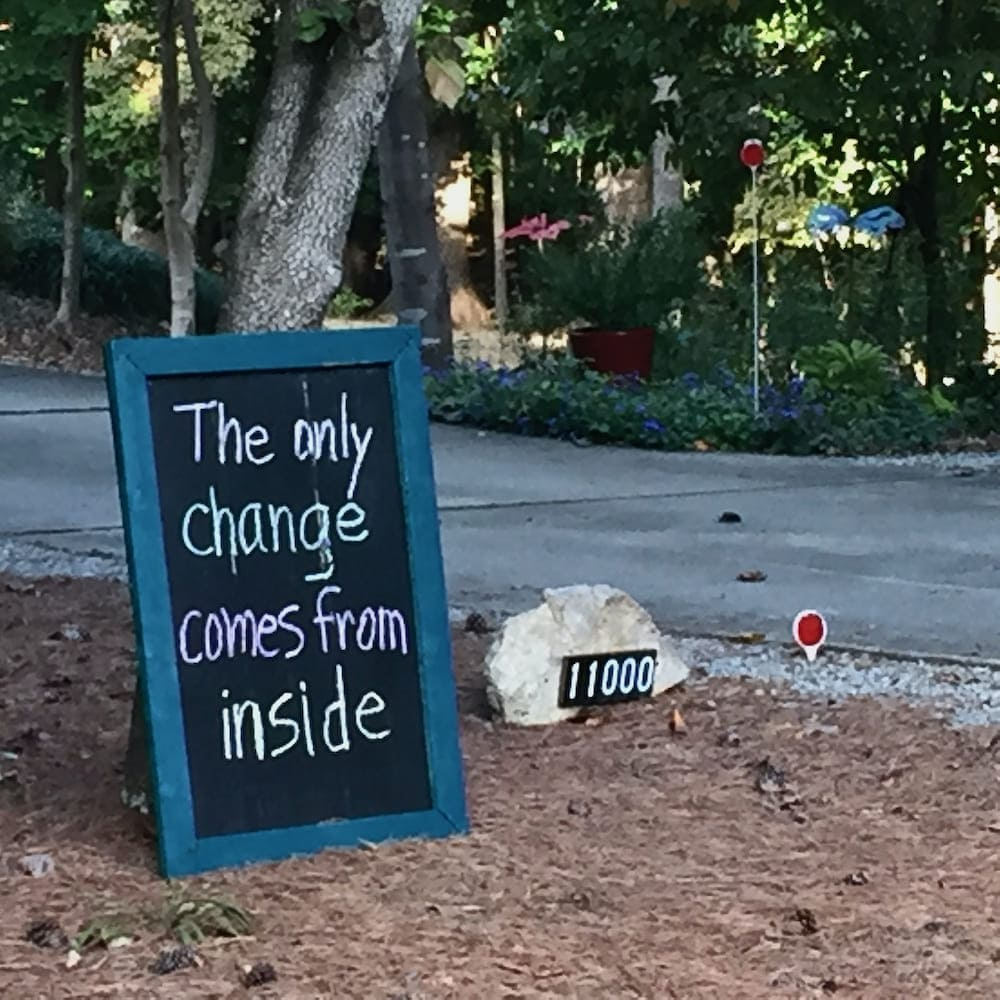 Chalkboard in yard with encouraging message