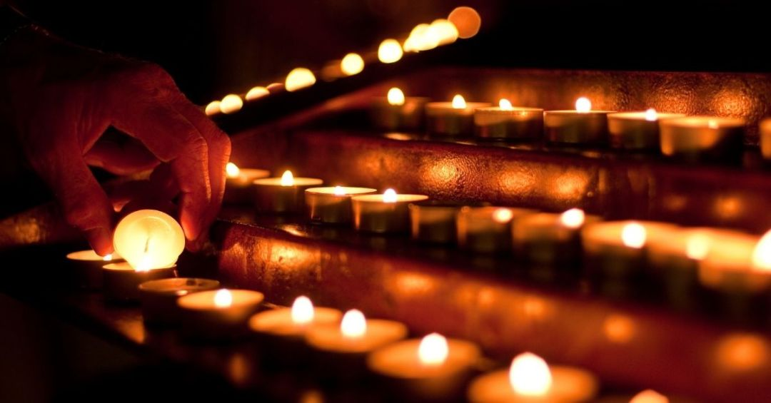 Devotional Candles lit in a Church illustrating power of small acts of service
