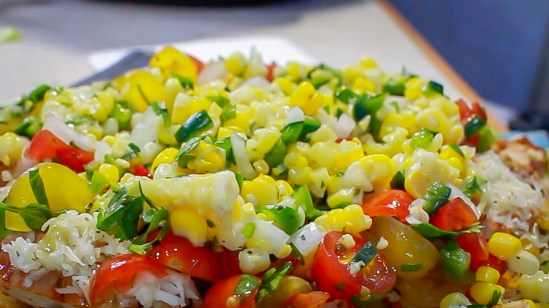 Corn Salsa on top of our homemade chipotle chicken burrito bowl.
