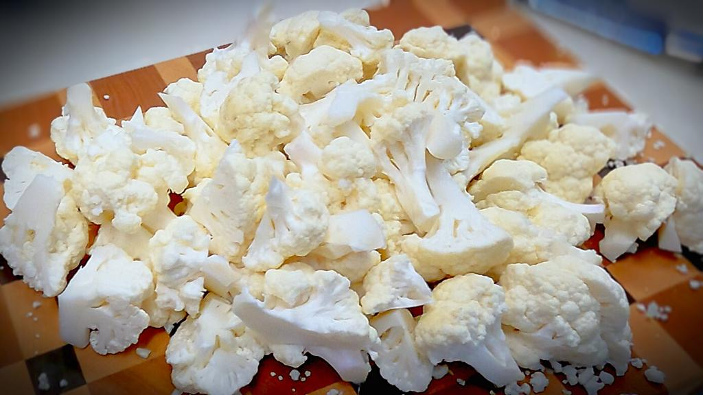slice one head of cauliflower for Philly cheesesteaks