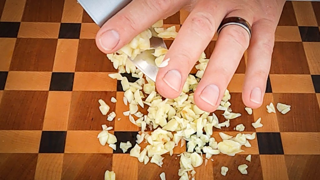 Dice 6 large cloves of garlic.  Use a sharp knife and end grain wood cutting board.