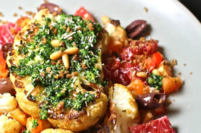 Cauliflower steaks rubbed with chipotle spices, served over a citrus salad, and topped with a kale pesto.