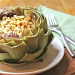 Artichoke Filled with Citrus, Olive and Raisin Couscous