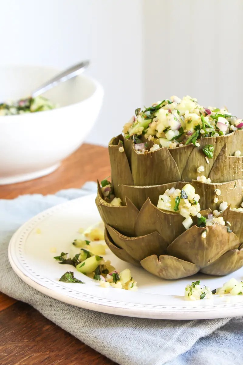 Steamed artichokes stuffed with quinoa, cucumber, red onion, mint and parsley.